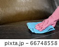 Woman wipe sofa with germicidal spray and wipe with towel. 66748558