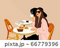 Woman at the french cafe 66779396