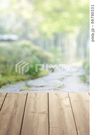 Wooden table on blurred nature green background 66790331