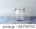 Empty money jar with covid19 label 66799702