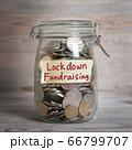 money jar with lockdown fundraising label. 66799707