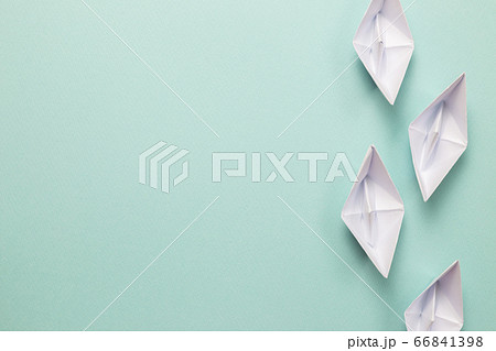 White paper ships on blue background. ships heading for the same destination. Business, success, competition, goal concept 66841398