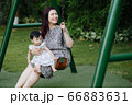 Mother and kids outdoor having fun 66883631