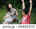 Mother and kids outdoor having fun 66883633