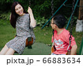 Mother and kids outdoor having fun 66883634