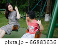 Mother and kids outdoor having fun 66883636
