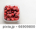 Frozen strawberries and cherry in container  66909800
