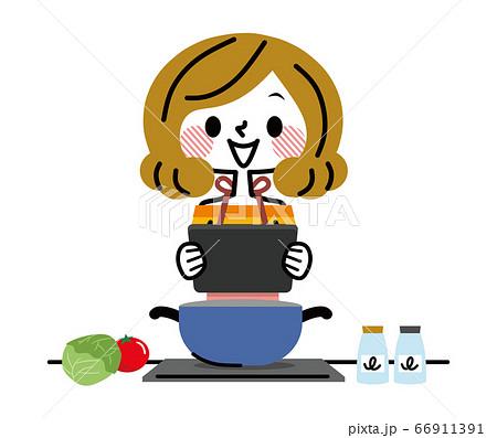 タブレットを見て料理する女性 66911391