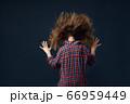 Little girl against powerful airflow in studio 66959449