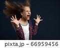 Little girl against powerful airflow in studio 66959456