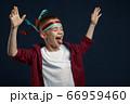 Little boy screams in studio, windy effect 66959460