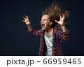 Little kid screams in studio, developing hairstyle 66959465