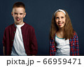 Little boy and girl making faces in studio 66959471