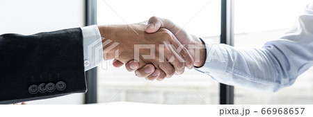 Greeting new colleagues, Handshake while job 66968657