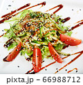 Salad with eel, cucumber, tomato on a plate of 66988712