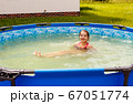 teen girl is swimming in a small pool 67051774