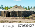 old soldiers canvas tents torn in the wind 67056427