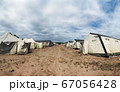 old soldiers canvas tents torn in the wind in the field 67056428