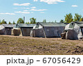 old soldiers canvas tents torn in the wind in the field 67056429