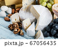 different varieties and types of cheese with fruits 67056435