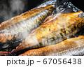mackerel fish is smoked until Golden brown 67056438