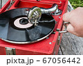 old retro gramophone with a vinyl record 67056442