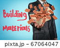 Anonymous businessman levitating cardboard box with lots of red perforated bricks flying out of it on blue background with title 'Building Materials'. 67064047