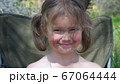 Portrait of a smiling little girl 67064444