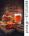 american hamburger with glass of beer in american restaurant or pub 67101098