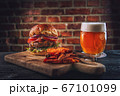 american hamburger with glass of beer in american restaurant or pub 67101099