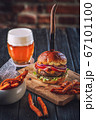 american hamburger with glass of beer in american restaurant or pub 67101100