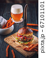 american hamburger with glass of beer in american restaurant or pub 67101101