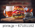 american hamburger with glass of beer in american restaurant or pub 67101102