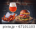 american hamburger with glass of beer in american restaurant or pub 67101103