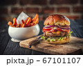 american hamburger with glass of beer in american restaurant or pub 67101107