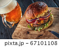 american hamburger with glass of beer in american restaurant or pub 67101108
