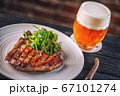 beef steak with sauce and salad, served with beer, product photography 67101274
