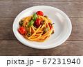 Spaghetti in tomato sauce. 67231940