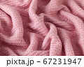 Knitted texture. Pattern fabric made of wool. 67231947