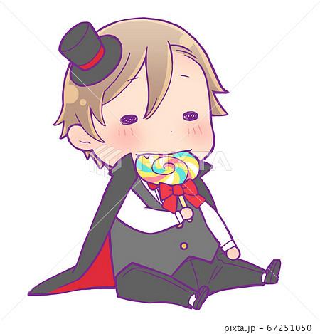座ってキャンディを食べているハロウィン仮装の男の子_吸血鬼 67251050