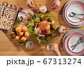 family eat chicken sitting at celebration dinner on christmas eve 67313274