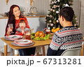 happy family drink beverages sitting at festive dinner 67313281