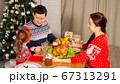 family joins hands and congratulates for New Year at supper 67313291