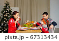 happy family drink beverages sitting at festive dinner 67313434