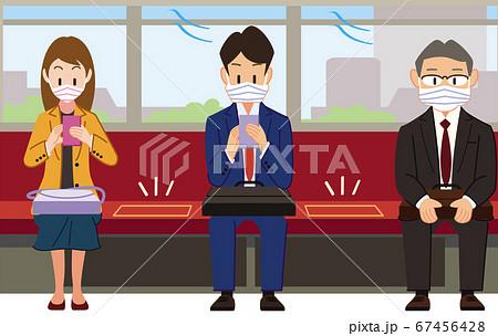 一席空けて座るビジネスマン 67456428