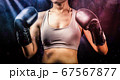Woman wear boxing gloves 67567877