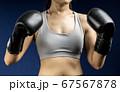 Woman wear boxing gloves 67567878
