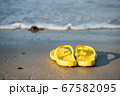 flip flops on beach at sunny day 67582095