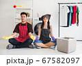 Young Asian couple yoga, wait laundry washing 67582097