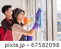 Asian couple cleaning window. Housework together 67582098
